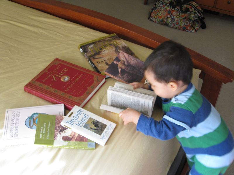 Ravi Playing with Daddy's Favorite Books