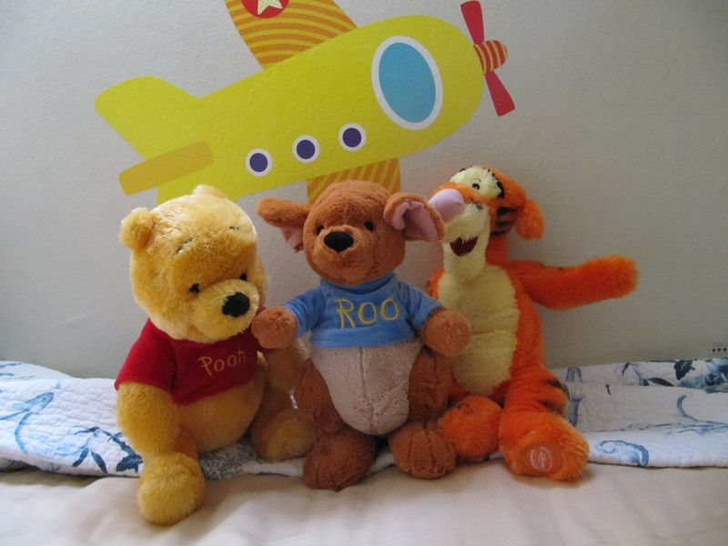 Winnie the Pooh, Roo, and Tiger -- what a happy family!
