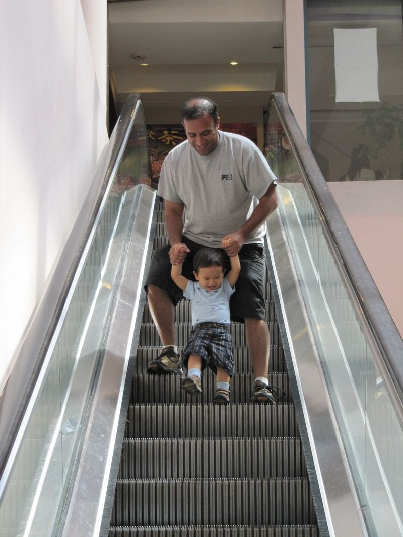 I love ridding the escalator with my daddy!